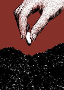 Hand mit Samenkorn